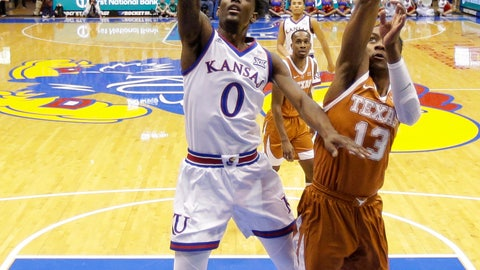 <p>               Kansas guard Marcus Garrett (0) gets past Texas guard Jase Febres (13) to put up a shot during the first half of an NCAA college basketball game Monday, Jan. 14, 2019, in Lawrence, Kan. (AP Photo/Charlie Riedel)             </p>