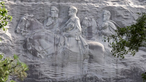 "<p>               FILE - This June 23, 2015, file photo shows a carving depicting Confederates Stonewall Jackson, Robert E. Lee and Jefferson Davis in Stone Mountain, Ga. A coalition of civil rights groups in Atlanta is using this year's Super Bowl to kick off a renewed ""war on the Confederacy,"" in a fight to remove Confederate monuments around the nation (AP Photo/John Bazemore, File)             </p>"