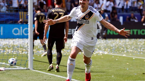 <p>               FILE - In this March 31, 2018, file photo, Los Angeles Galaxy's Zlatan Ibrahimovic, of Sweden, celebrates his second goal of the game during the second half of an MLS soccer match against the Los Angeles FC in Carson, Calif. The 37-year-old Ibrahimovic is returning to the Galaxy for a second season despite gathering interest from European clubs. The Swedish superstar was disappointed in the Galaxy's overall performance last year despite his own strong debut in Major League Soccer. (AP Photo/Jae C. Hong, File)             </p>