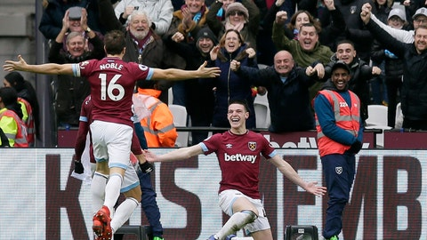 <p>               West Ham's Declan Rice, right, celebrates after scoring the opening goal during the English Premier League soccer match between West Ham United and Arsenal at London Stadium in London, Saturday, Jan. 12, 2019. (AP Photo/Tim Ireland)             </p>