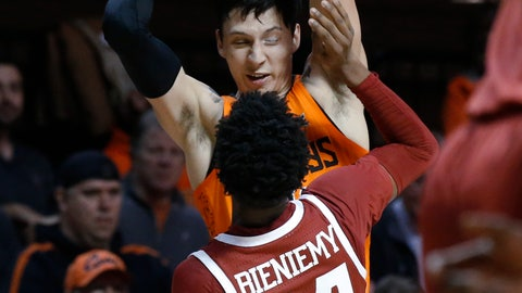 <p>               Oklahoma State guard Lindy Waters III, rear, is defended by Oklahoma guard Jamal Bieniemy (24) during the first half of an NCAA college basketball game in Stillwater, Okla., Wednesday, Jan. 23, 2019. (AP Photo/Sue Ogrocki)             </p>