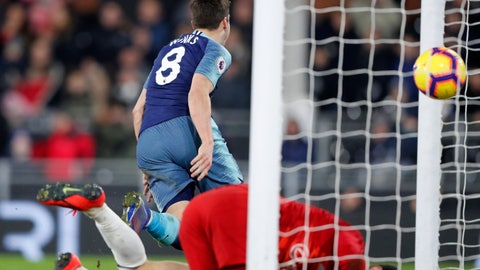 <p>               Tottenham Hotspur's Harry Winks turns and runs away to celebrate after scoring his sides 2nd goal during the English Premier League soccer match between Fulham and Tottenham Hotspur at Craven Cottage in London, Sunday, Jan. 20, 2019. (AP Photo/Frank Augstein)             </p>