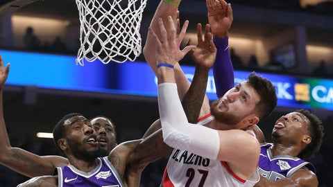 <p>               Portland Trail Blazers center Jusuf Nurkic, center, goes up for the rebound between Sacramento Kings' Iman Shumpert, left, and Buddy Hield during the first quarter of an NBA basketball game Monday, Jan. 14, 2019, in Sacramento, Calif. (AP Photo/Rich Pedroncelli)             </p>