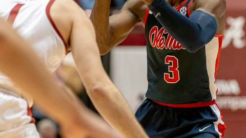 <p>               Mississippi guard Terence Davis (3) looks for a passing lane as he is defended by Alabama's Riley Norris (1) during the first half of an NCAA college basketball game, Tuesday, Jan. 22, 2019, in Tuscaloosa, Ala. (AP Photo/Vasha Hunt)             </p>