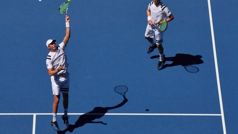 <p>               FILE - In this Jan. 19, 2018 file photo, United States' Bob and Mike Bryan play in the men's doubles second round match against Max Mirnyi of Belarus and Austria's Phillip Oswald at the Australian Open tennis championships in Melbourne, Australia.The Bryan brothers have reunited as a doubles combination at a Grand Slam tournament and have opened with a 7-6 (4), 7-6 (1) win over Alex Bolt and Marc Polmans at the Australian Open in Melbourne, Australia, Wednesday Jan. 16, 2019. (AP Photo/Andy Brownbill,File)             </p>