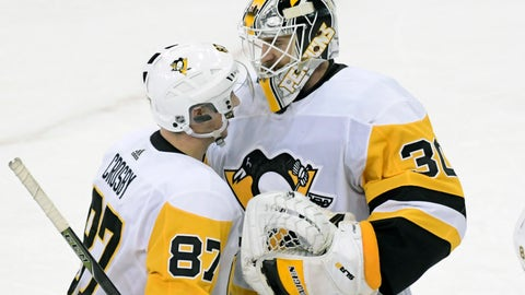 <p>               Pittsburgh Penguins goaltender Matt Murray (30) celebrates with Sidney Crosby (87) after the Penguins defeated the New York Rangers 7-2 in an NHL hockey game Wednesday, Jan. 2, 2019, at Madison Square Garden in New York. (AP Photo/Bill Kostroun)             </p>