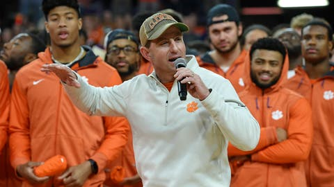 <p>               Clemson head football coach Dabo Swinney along with members of the 2019 National Championship football team address the crowd during the first half of an NCAA college basketball game between Clemson and Virginia, Saturday, Jan. 12, 2019, in Clemson, S.C. (AP Photo/Richard Shiro)             </p>