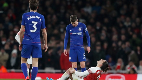 <p>               Chelsea's Jorginho looks down as Arsenal's Hector Bellerin goes down injured holding his knee during the English Premier League soccer match between Arsenal and Chelsea at the Emirates stadium in London, Saturday, Jan. 19, 2019. (AP Photo/Frank Augstein)             </p>