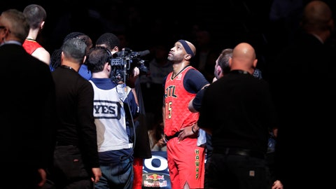 <p>               Atlanta Hawks' Vince Carter (15) watches a video tribute to him during the first half of the team's NBA basketball game against the Brooklyn Nets on Wednesday, Jan. 9, 2019, in New York. (AP Photo/Frank Franklin II)             </p>