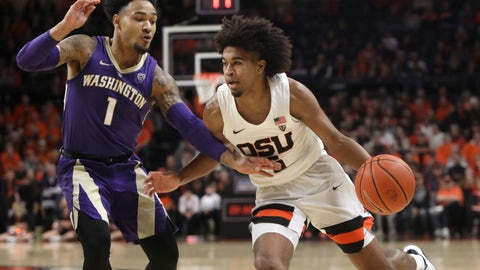 <p>               Oregon State's Ethan Thompson, right, is guarded by Washington's David Crisp (1) during the first half of an NCAA college basketball game in Corvallis, Ore., Saturday, Jan. 26, 2019. (AP Photo/Amanda Loman)             </p>