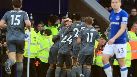 <p>               Leicester City's Jamie Vardy looks out as he is mobbed by team-mates after scoring his sides first goal of the game against Everton, during their English Premier League soccer match at Goodison Park in Liverpool, England, Tuesday Jan. 1, 2019. (Peter Byrne/PA via AP)             </p>