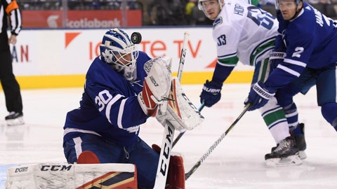<p>               Toronto Maple Leafs goaltender Michael Hutchinson (30) makes a save as Toronto Maple Leafs defenseman Ron Hainsey (2) and Vancouver Canucks center Bo Horvat (53) look on during the second period of an NHL hockey game, Saturday, Jan. 5, 2019, in Toronto. (Nathan Denette/The Canadian Press via AP)             </p>