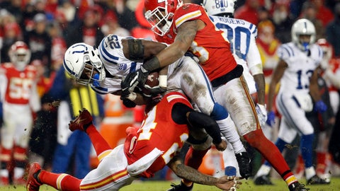 <p>               Kansas City Chiefs linebacker Anthony Hitchens, top, and safety Jordan Lucas (24) tackle Indianapolis Colts running back Marlon Mack (25) during the second half of an NFL divisional football playoff game in Kansas City, Mo., Saturday, Jan. 12, 2019. (AP Photo/Charlie Riedel)             </p>