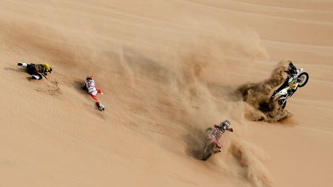 <p>               Husqvarna motorbike rider Jan Brabec, of Czech Republic, left, and KTM rider Cesar Pardo, of Peru, fall on the sand dunes during stage nine of the Dakar Rally in Pisco, Peru, Wednesday, Jan. 16, 2019. (AP Photo/Ricardo Mazalan)             </p>