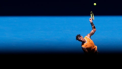 <p>               Spain's Rafael Nadal serves to Australia's James Duckworth in their first round match at the Australian Open tennis championships in Melbourne, Australia, Monday, Jan. 14, 2019. (AP Photo/Aaron Favila)             </p>