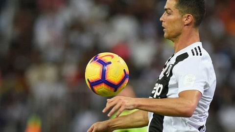 <p>               Juventus' Cristiano Ronaldo controls the ball during of the Italian Super Cup final soccer match between AC Milan and Juventus at King Abdullah stadium in Jiddah, Saudi Arabia, Wednesday, Jan. 16, 2019. (AP Photo)             </p>