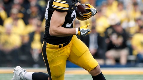 <p>               FILE - In this Oct. 7, 2017, file photo, Iowa tight end T.J. Hockenson catches a pass during the second half of an NCAA college football game against Illinois, in Iowa City, Iowa. Hockenson is leaving school early for the NFL. The Hawkeyes announced on Monday, Jan. 14, 2019,  that Hockenson, a redshirt sophomore, will join teammates Noah Fant, Anthony Nelson and Amani Hooker as early entrees in the draft. (AP Photo/Charlie Neibergall, File)             </p>