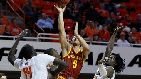 <p>               Iowa State guard Lindell Wigginton (5) shoots between Oklahoma State forward Yor Anei (14) and guard Isaac Likekele (13) during the second half of an NCAA college basketball game in Stillwater, Okla., Wednesday, Jan. 2, 2019. (AP Photo/Sue Ogrocki)             </p>