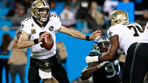 <p>               FILE - In this Dec. 17, 2018, file photo, New Orleans Saints' Drew Brees (9) scrambles away from a Carolina Panthers defender during the first half of an NFL football game in Charlotte, N.C. Offense wins championships in the new NFL. For the first time since the league expanded to 32 teams in 2002, none of the teams playing in the conference title game have a defense ranked in the top 10 in total yards. Only New England is among the top 10 in fewest points allowed. But, the Chiefs, Patriots, Saints and Rams do possess the four most prolific offenses in the league. (AP Photo/Jason E. Miczek, File)             </p>