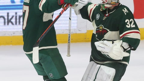 <p>               Minnesota Wild goalie Alex Stalock, right, and teammate Marcus Foligno celebrate the Wild's 3-2 shootout win in an NHL hockey game against the Los Angeles Kings on Tuesday, Jan. 15, 2019, in St. Paul, Minn. (AP Photo/Jim Mone)             </p>