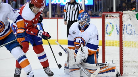 <p>               New York Islanders goaltender Thomas Greiss (1) stops the puck next to Washington Capitals right wing T.J. Oshie (77) during the second period of an NHL hockey game Friday, Jan. 18, 2019, in Washington. (AP Photo/Nick Wass)             </p>