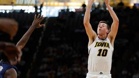 <p>               Iowa guard Joe Wieskamp (10) shoots a three-point basket against Illinois during the second half of an NCAA college basketball game, Sunday, Jan. 20, 2019, in Iowa City. (AP Photo/Matthew Putney)             </p>