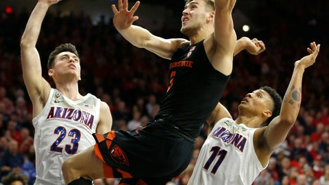 <p>               Oregon State forward Tres Tinkle (3) drives between Arizona guard Alex Barcello and Ira Lee (11) in the first half during an NCAA college basketball game, Saturday, Jan. 19, 2019, in Tucson, Ariz. (AP Photo/Rick Scuteri)             </p>