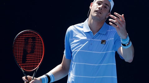 <p>               United States' John Isner reacts during his first round match against compatriot Reilly Opelka at the Australian Open tennis championships in Melbourne, Australia, Monday, Jan. 14, 2019. (AP Photo/Mark Schiefelbein)             </p>