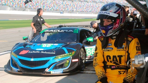 <p>               Katherine Legge of England waits to drive during a test session at Daytona International Speedway in Daytona Beach, Fla., Friday, Jan. 4, 2019. Legge is part of an all-female-driver team racing in the Rolex 24 at Daytona later this month. (AP Photo/Mark Long)             </p>