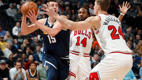 <p>               Denver Nuggets center Nikola Jokic, left, looks to pass the ball as Chicago Bulls forwards Wayne Selden Jr., center, and Lauri Markkanen defend in the first half of an NBA basketball game, Thursday, Jan. 17, 2019, in Denver. (AP Photo/David Zalubowski)             </p>