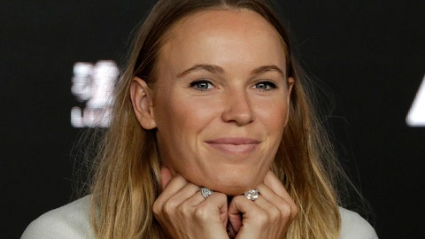 <p>               Defending women's singles champion Denmark's Caroline Wozniacki answers questions during a press conference at the Australian Open tennis championships in Melbourne, Australia, Sunday, Jan. 13, 2019. (AP Photo/Kin Cheung)             </p>