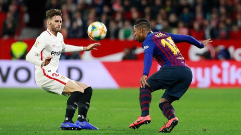 <p>               Sevilla's Sergi Gomez, left, fight for the ball with FC Barcelona's Malcom, during a Spanish Copa del Rey soccer match between Sevilla and FC Barcelona at the Ramon Sanche Pizjuan stadium in Seville, Spain, Wednesday Jan. 23, 2019. (AP Photo/Miguel Morenatti)             </p>