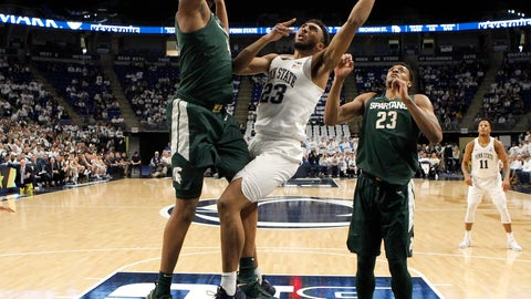 <p>               Penn State's Josh Reaves (23) goes to the basket as Michigan State's Nick Ward (44) defends during first-half action of an NCAA college basketball game in State College, Pa. Sunday, Jan. 13, 2019. (AP Photo/Chris Knight)             </p>