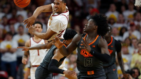 <p>               Iowa State guard Talen Horton-Tucker, left, throws the ball for a breakaway during the first half of the team's NCAA college basketball game against Oklahoma State, Saturday, Jan. 19, 2019, in Ames. At right is Oklahoma State's Isaac Likekele. (AP Photo/Matthew Putney)             </p>