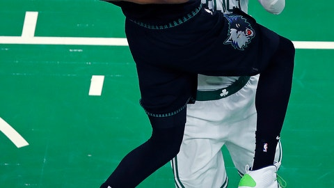 <p>               Minnesota Timberwolves center Karl-Anthony Towns, left, is fouled by Boston Celtics forward Marcus Morris on a drive to the basket during the third quarter of an NBA basketball game in Boston, Wednesday, Jan. 2, 2019. (AP Photo/Charles Krupa)             </p>