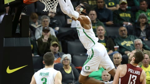 <p>               Oregon's Kenny Wooten, top, dunks over teammate Payton Pritchard, left and Washington State's Jeff Pollard, right, during the second half of an NCAA college basketball game Sunday, Jan 27, 2019, in Eugene, Ore. (AP Photo/Chris Pietsch)             </p>