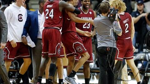 <p>               South Carolina players celebrate after defeating Vanderbilt 74-71 in an NCAA college basketball game Wednesday, Jan. 16, 2019, in Nashville, Tenn. (AP Photo/Mark Humphrey)             </p>