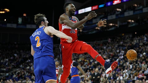 <p>               Washington Wizards forward Jeff Green (32), right, is fouled by New York Knicks forward Luke Kornet (2) during an NBA basketball game between New York Knicks and Washington Wizards at the O2 Arena, in London, Thursday, Jan.17, 2019. (AP Photo/Alastair Grant)             </p>