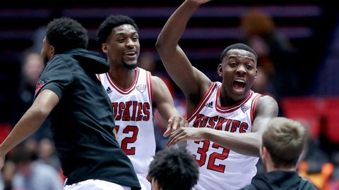 <p>               Northern Illinois' Levi Bradley (42) and Austin Richie (32) celebrate with teammates after Northern Illinois defeated Buffalo 77-75 in an NCAA college basketball game Tuesday, Jan. 22, 2019, in DeKalb, Ill. (AP Photo/Nam Y. Huh)             </p>