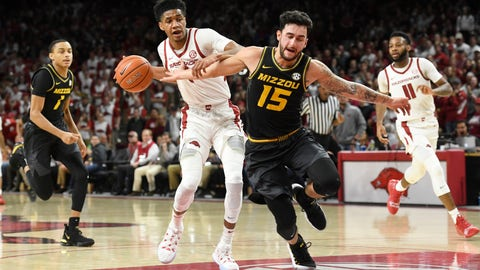 <p>               Arkansas guard Isaiah Joe (1) steals the ball and tries to drive past Missouri guard Jordan Geist (15) during the first half of an NCAA college basketball game, Wednesday, Jan. 23, 2019 in Fayetteville, Ark. (AP Photo/Michael Woods)             </p>