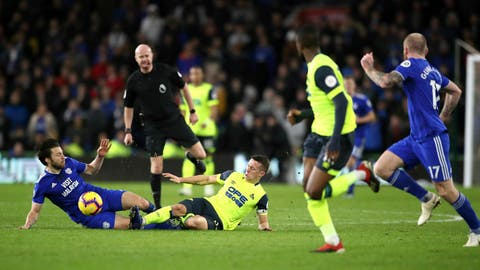 <p>               Cardiff City's Lee Tomlin, left, and Huddersfield Town's Jonathan Hogg battle for the ball during the English Premier League soccer match between Cardiff City and Huddersfield Town at the Cardiff City Stadium, Cardiff, Wales. Saturday, Jan. 12, 2019. (Nick Potts/PA via AP)             </p>