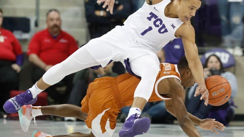 <p>               TCU guard Desmond Bane (1) and Texas guard Matt Coleman III (2) vie for control of the ball during the first half of an NCAA college basketball game in Fort Worth, Texas, Wednesday, Jan. 23, 2019. (AP Photo/LM Otero)             </p>