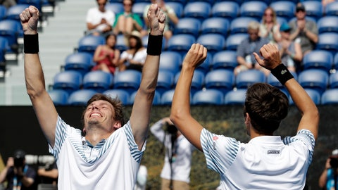 <p>               France's Nicolas Mahut, right, and compatriot Pierre-Hugues Herbet celebrate after defeating Finland's Henri Kontinen and Australia's John Peers in the men's doubles final at the Australian Open tennis championships in Melbourne, Australia, Sunday, Jan. 27, 2019.(AP Photo/Aaron Favila)             </p>