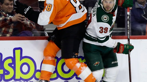 <p>               Philadelphia Flyers' Robert Hagg, left, collides with Minnesota Wild's Nate Prosser during the third period of an NHL hockey game, Monday, Jan. 14, 2019, in Philadelphia. Philadelphia won 7-4. (AP Photo/Matt Slocum)             </p>