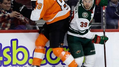 <p>               Philadelphia Flyers' Robert Hagg, left, collides with Minnesota Wild's Nate Prosser during the third period of an NHL hockey game, Monday, Jan. 14, 2019, in Philadelphia. Philadelphia won 7-4. (AP Photo/Matt Slocum)             </p>