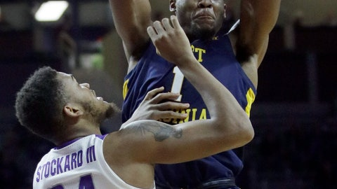 <p>               West Virginia forward Derek Culver (1) passes to a teammate while covered by Kansas State forward Levi Stockard III (34) during the first half of an NCAA college basketball game in Manhattan, Kan., Wednesday, Jan. 9, 2019. (AP Photo/Orlin Wagner)             </p>