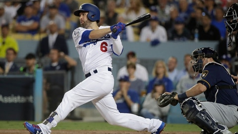 <p>               FILE - In this Oct. 16, 2018, file photo, Los Angeles Dodgers' Brian Dozier hits an RBI single during the first inning of Game 4 of the National League Championship Series baseball game against the Milwaukee Brewers, in Los Angeles. A person familiar with the negotiations tells The Associated Press that free-agent second baseman Brian Dozier and the Washington Nationals have agreed to a $9 million, one-year contract, subject to the successful completion of a physical exam.  The person confirmed the deal on condition of anonymity Thursday, Jan. 10, 2019, because neither the club nor player had announced anything. (AP Photo/Jae Hong, File)             </p>