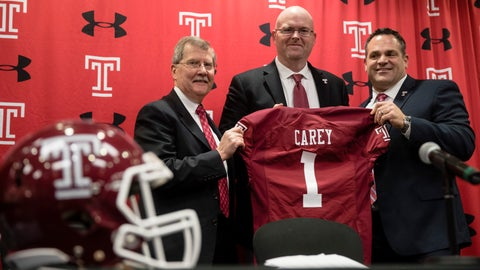 <p>               Temple University's President Richard Englert, left, and director of athletics, Patrick Kraft, right, pose for photographs with incoming head coach Rod Carey, center, speaks during an NCAA college football news conference in Philadelphia, Friday, Jan. 11, 2019. (AP Photo/Matt Rourke)             </p>