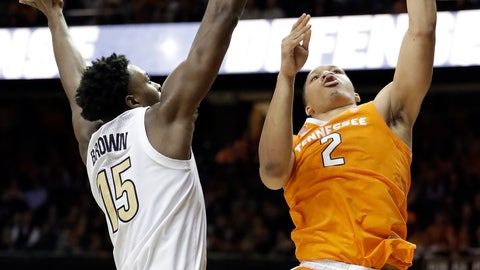 <p>               Tennessee forward Grant Williams (2) scores against Vanderbilt forward Clevon Brown (15) in the second half of an NCAA college basketball game Wednesday, Jan. 23, 2019, in Nashville, Tenn. Williams scored a career-high 41 points and was 23 for 23 at the free throw line as Tennessee won 88-83 in overtime. (AP Photo/Mark Humphrey)             </p>
