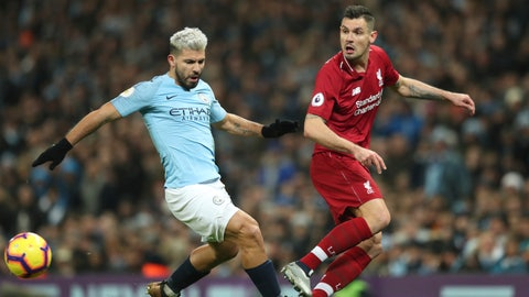 <p>               Liverpool's Dejan Lovren, right gets the ball away from Manchester City's Sergio Aguero during their English Premier League soccer match between Manchester City and Liverpool at the Ethiad stadium, Manchester England, Thursday, Jan. 3, 2019. (AP Photo/Jon Super)             </p>